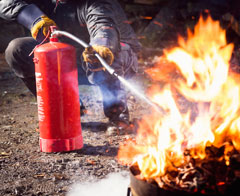 photo of fire extinguisher in use