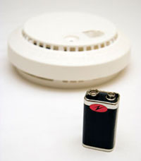 photo of smoke detector with battery